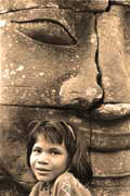 Young girl posing, upper terrace, Bayon